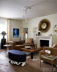 In the living room of Larry Laslo's Palm Beach, Florida, home, the sofas, cocktail table, mirror, and sconces are his own designs.