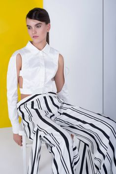 LARA QUINT SS'15. Short slim fit cotton-atlas white shirt with cut away parts. Wide stretch cotton black and white striped hip maxi trousers with two additional trouser legs. #LaraQuint #collection #avantgarde #blouse #trousers #pants #top #fashion #style #fashionstyle #look #outfit #lookbook #model #pretaporter #apparel #fashiondesigner #fashiondesign #blackandwhite #stripes #detail #details #ss15
