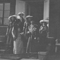Grand Duchesses Tatiana and Olga, Alexandra Feodorovna, Grand Duchess Maria, the Tsar and Grand Duchess Anastasia on the steps of the hunting lodge.
