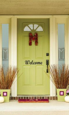 WELCOME Vinyl decal on Front Door. It looks great on this pretty green front door. Nice color.