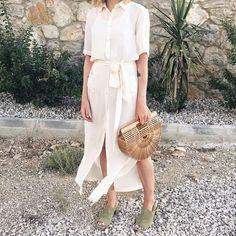 blogger brittany bathgate in her scandi sandals   See this Instagram photo by @fuggiamo #shopfuggiamo #cultgaia #wickerbag