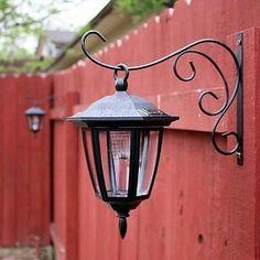 Hang dollar store solar lights on basket hooks.