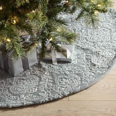 Our damask-pattern-on-faux-fur tree skirt creates an elegantly decorated backdrop for your perfectly wrapped presents. Let the shimmering silver tones and intricate detailing add sophistication to your holiday decor. Exclusively Pier 1.