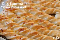 Cheesy Breadsticks made from scratch in under an hour! Soft, buttery and filled with cheese, these are the best breadstick recipe ever!
