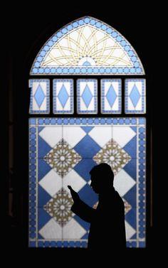 A Muslim man prays during the holy month of Ramadan at Al Farooq Mosquein Dubai, United Arab Emirates.