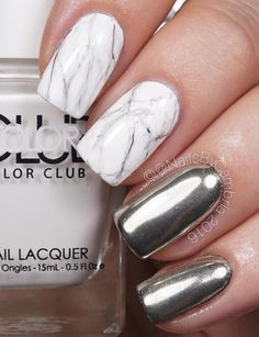 Moderate length of the nail is still desirable because it can be worn in all circumstances and not only at parties. Here is a nice integrated marbel design with silver chrome powder.