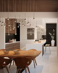 Great open space, we love the light installation over the table and the open floor plan