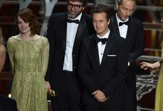 Actors Edward Norton and Emma Stone accept the Best Picture award for 'Birdman' onstage during the 87th Annual Academy Awards