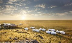 Truly getting away from it: Traditional yurts are scattered across the plains of the Gobi...