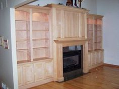 Maple Bookshelves and Mantel Surround but with a tv on top of the fireplace- great having the TV Hidden when not in use.