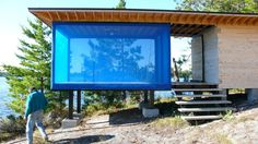 """The Island The """"Blue Cube"""" is located on Grindstone Island, one of many islands which dot the watery landscape of Rainy Lake in Northern Minnesota. Rainy Lake, Timber Frame Homes, Glass Boxes, Simple Lines, Interior And Exterior, Facade, Cube, Living Spaces, Landscape"""
