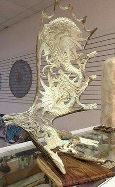 Dragon carved moose antler.... beautiful.. but I do hope it died of natural causes. <3 :) http://www.ebay.com/itm/111027151177?ssPageName=STRK:MEWAX:IT&_trksid=p3984.m1438.l2649