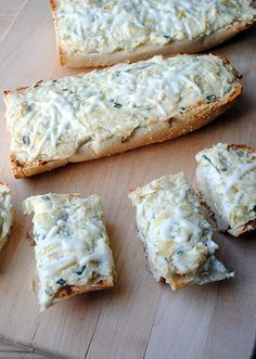 Artichoke Bread~T~ Oh so good. I use Marinated Artichoke hearts. Drain well. Great with dinner or cocktails.