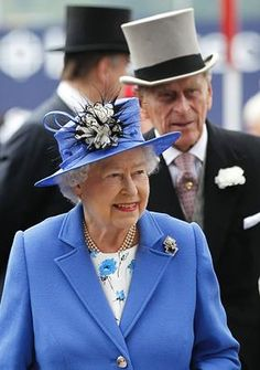 Britain's Queen Elizabeth II and Prince Philip arrive for the Epsom Derby at Epsom race course, southern England at the start of four-day Diamond Jubilee celebrations. (Sang Tan/Getty Images)
