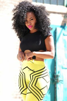 Lets just make a list of things to love in this picture shall we? 1. Her hair is absolutely gorgeous! 2. Her eye brows and make up! 3. Her outfit. And 4. I want curves like that!