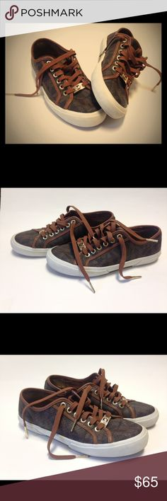 Michael Kors Ladies Casual Lace-Up Shoe Michael Kors trademark design on rich brown leather. Signature MK on golden lace plate. Lace tips fixed with solid gold plated Signature MK stamped clamps. Smooth cream and tan shoe soles. Michael Kors Shoes Athletic Shoes