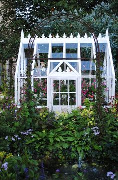 such a pretty little greenhouse