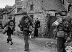 The liberation of Saint-Marcouf. Soldiers off the beaches march through the town to the delight of Jean Tissier, an eighteen-year-old citizen of the town.