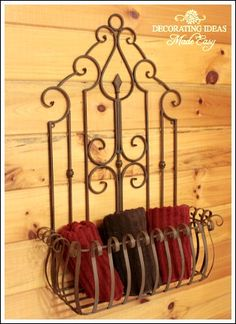 this metal decor makes a great place for towels. It is the perfect size for hanging on the wall above your toilet. Simply find some towels that match your bathroom decor, roll them up and lay them in the wire basket. Easy and cheap decorating!