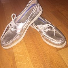 Gold/silver boat shoes Well loved but still have life in them! Sperry Top-Sider Shoes Flats & Loafers