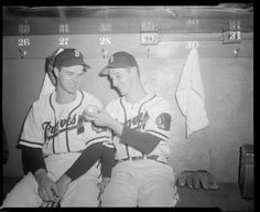 Boston Braves pitchers Johnny Sain and Warren Spahn in dugout at Braves Field ca., 1948.