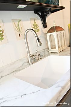 undermount Karran sink with calcutta marble finish...formica?? gotta feel it to believe it's as good as it looks.