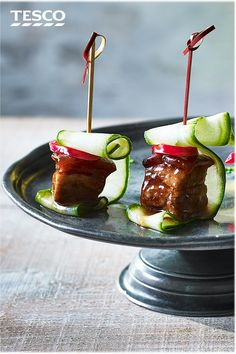 Impress your guests at your next drinks party with this easy pork belly canapé recipe. Inspired by Asian flavours, sticky hoisin pork belly squares are skewered with spicy chilli and refreshing cucumber. | Tesco #pork #canapes