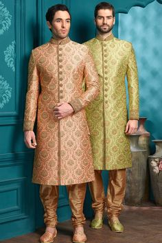 Admirable Peach color silk indo western with golden churidar is giving rich look to it. Stylish indo western will make you shine out on your special day. Men Wedding Attire Guest, Wedding Dresses Men Indian, African Prom Dresses, Strapless Prom Dresses, Wedding Suits, Teal Green Dress, Green Dress Outfit, Dusty Pink Dresses, Floral Dresses With Sleeves
