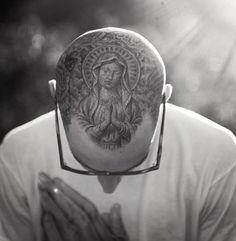 Travis Barker's head tattoo by Mr. Cartoon