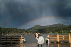 rain at wedding, evergreen colorado, wedding photos, groom, bride, rainy ceremony, wedding rainbow