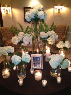 Entrance Table, floating candles and white hydrangeas