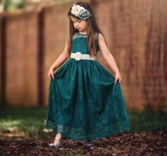 The color of this dress will knock her socks off!  Soft emerald lace in vintage styling, make this lace gown a photographers dream. https://trishscully.com/alexandra-dress-belt-set-emerald/