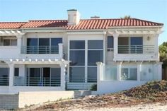 What more could you ask for?? This home SITS on the sand with white water, full ocean views from 3 balconies, 2 patios and floor to ceiling windows. It is located right off of Hwy 1, two miles south of Pismo Beach and two ...