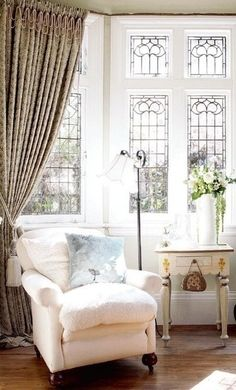 I love these leaded glass windows, and the chair, great for relaxing and reading