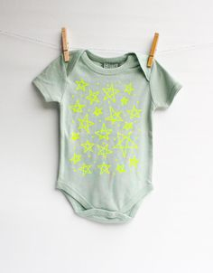 bodysuit is printed by hand, please allow for very slight variations.    PRODUCT DETAILS  100% Organic