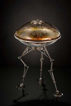 Rik Allen makes ridiculously cool metal and glass spaceships and robots.
