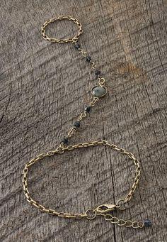 <ul><b>Overview</b><li>part of the Lacey Ryan Collection</li><li>gold-color nickle sensitive metal</li><li>beautiful stone and bead detail</li><li>trendy bracelet with attached ring hand jewelry</li></ul><ul><b>Fabric and Care</b><li>Style Number: 32266</li><li>Imported</li><li>70% metal 20% glass 10% spectrolite</li><li>Wipe clean</li></ul>