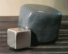 Magnetic putty engulfs piece of metal.