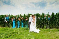 This photo screams Nebraska! Wedding party poking through the cornfield.