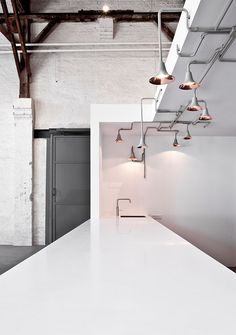 To create a showroom that matched the elegant collection of Danish design brand &tradition, Norm Architects took a step outside of the box (pun intended). Rather than a standard space, the architects turned the interior of a vast warehouse in cent. Modern Interior Design, Interior Architecture, Interior And Exterior, Ampoule Design, Berlin Design, Danish Design, Ceiling Lamp, Interiores Design, Kitchen Interior