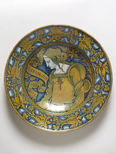 Tin-glazed earthenware dish (maiolica), painted in cobalt-blue and yellow lustre with a portrait of lady. Deruta, about 1520.
