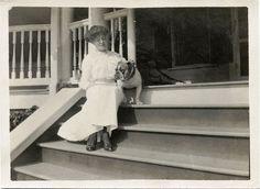 BULLDOG DOG SITTING ON PORCH OF HOUSE