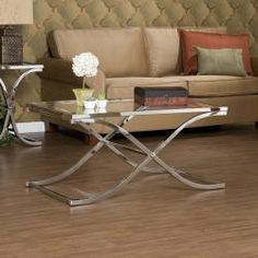 So my style. Adding to the new apt list! http://www.overstock.com/Home-Garden/Parker-Chrome-Cocktail-Table/5238229/product.html?CID=214117 $204.99