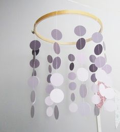 DIY mobile using paint chips and an embroidery hoop.