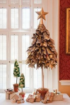 Article + Gallery ➤ http://CARLAASTON.com/designed/25-extraordinary-christmas-tree-designs 25 Extraordinary Christmas Trees Designed To Make Yours Look Ordinary (Image Source: http://pinterest.com/stainedpanes/ | Kw: holiday, newspaper, craft )