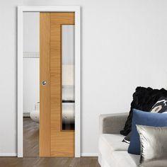 Single Pocket River Oak Modern Emral sliding door system in three size widths. #oakglazeddoor #pocketdoor #slidingpocketdoor