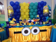 Despicable me party - minion face on yellow plastic table cloth. Door decoration?