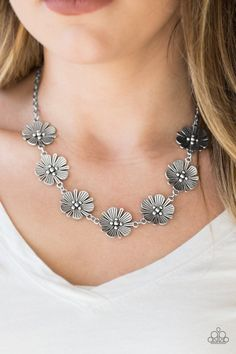 Featuring lifelike detail, a row of shimmery silver flowers links below the collar for a seasonal look. Features an adjustable clasp closure.Sold as one individual necklace. Includes one pair of matching earrings. Metal Necklaces, Metal Jewelry, Silver Necklaces, Pendant Jewelry, Silver Jewelry, Diamond Jewelry, Silver Ring, Statement Necklaces, Jewelry Necklaces
