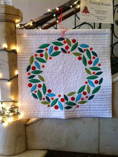 A Very Modern Wreath by Georgann Eglinski, quilted by Kris Barlow. Featured at Deb Rowden's blog