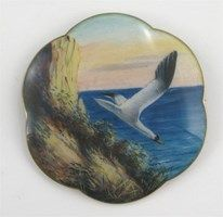 Gustav Gaudernack enamel brooch, decorated with a seagull diving from the cliff side